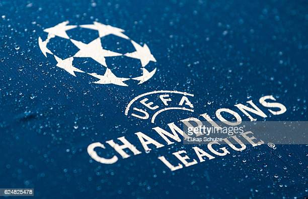 Rain drops are seen on a umbrella during a training session ahead of their Champions League match against Legia Warszawa at Dortmund Brackel Training...