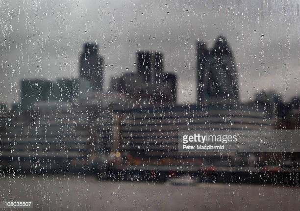 Rain drops coat a window at City Hall in view of London's financial square mile on January 14 2011 in London England