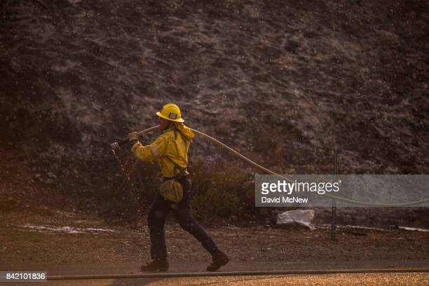 Rain drops fall around a firefighter during a brief rain event at the La Tuna Fire on September 2 2017 near Burbank California Los Angeles Mayor Eric...