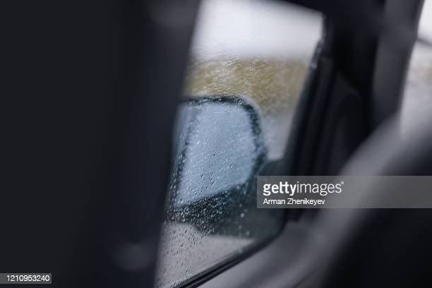 rain drops on the car window - arman zhenikeyev stock pictures, royalty-free photos & images