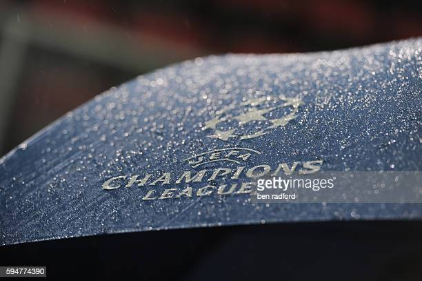 Rain drops on the UEFA Champions League logo on an umbrella during the UEFA Champions League Group A match between Twente Enschede and Inter Milan at...