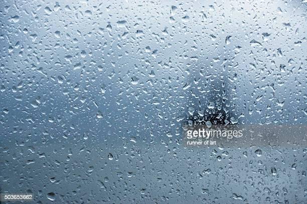 Rain drops on window in rainy day