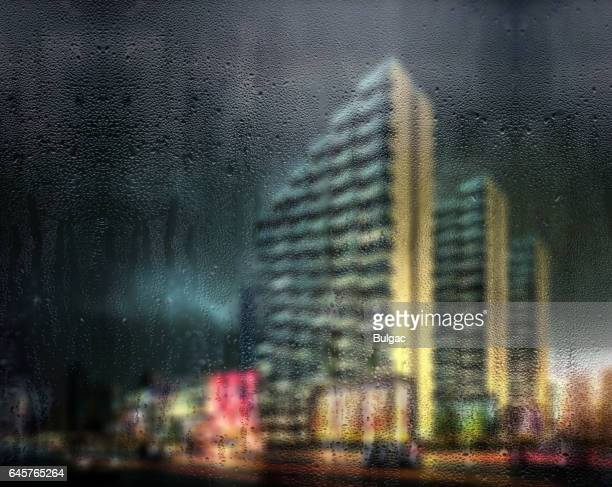 rain drops on window with defocused buildings in the background - kolkata stock pictures, royalty-free photos & images