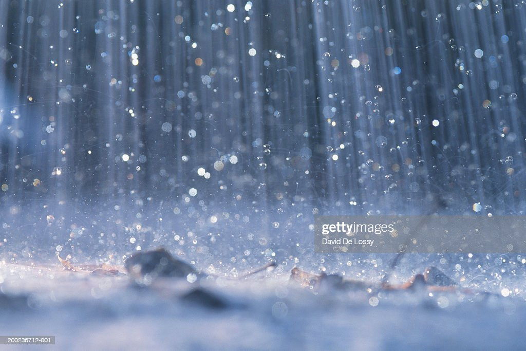 Rain falling on ground : Stock Photo