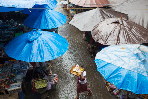 Rain falling over tarps and awnings of market stalls, Ubud, Bali, Indonesia - gettyimageskorea