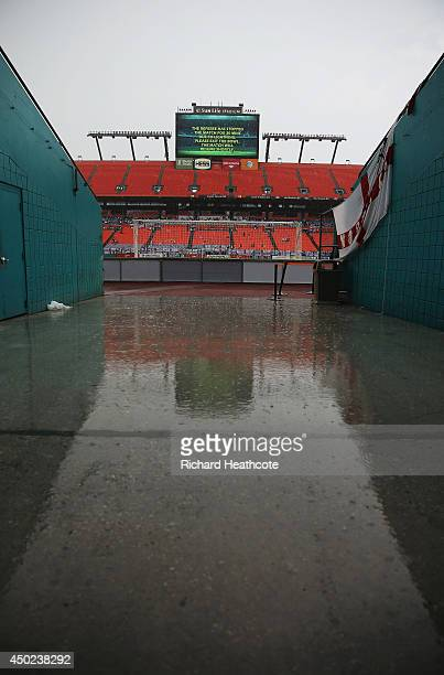 Rain falls as the game is delayed due to inclement weather during the International Friendly match between England and Honduras at Sun Life Stadium...