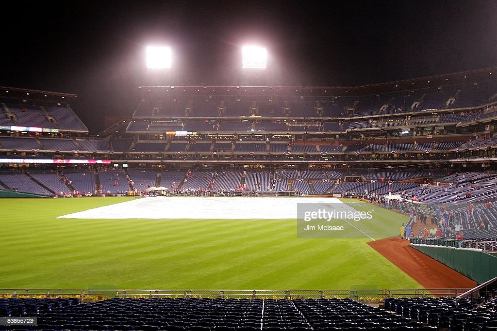 Rain falls as the tarp covers the infield prior to game three of the 2008 MLB World Series between the Philadelphia Phillies and the Tampa Bay Rays on October 25, 2008 at Citizens Bank Park in Philadelphia, Pennsylvania.