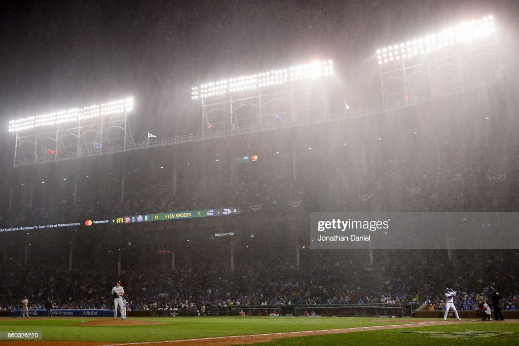 Rain falls in the eighth inning during game four of the National League Division Series between the Washington Nationals and the Chicago Cubs at Wrigley Field on October 11, 2017 in Chicago, Illinois.