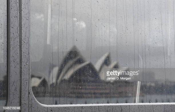 Rain falls on a bus window with the Opera House reflected in it on October 4 2018 in Sydney Australia Sydney is expected to have its wettest day in...