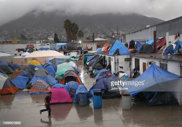 Rain falls on a migrant caravan camp on December 5 2018 in Tijuana Mexico Now near the USMexico border after traveling more than six weeks from...