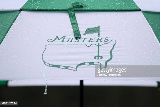 Rain falls on an umbrella during a practice round prior to the start of the 2017 Masters Tournament at Augusta National Golf Club on April 3 2017 in...