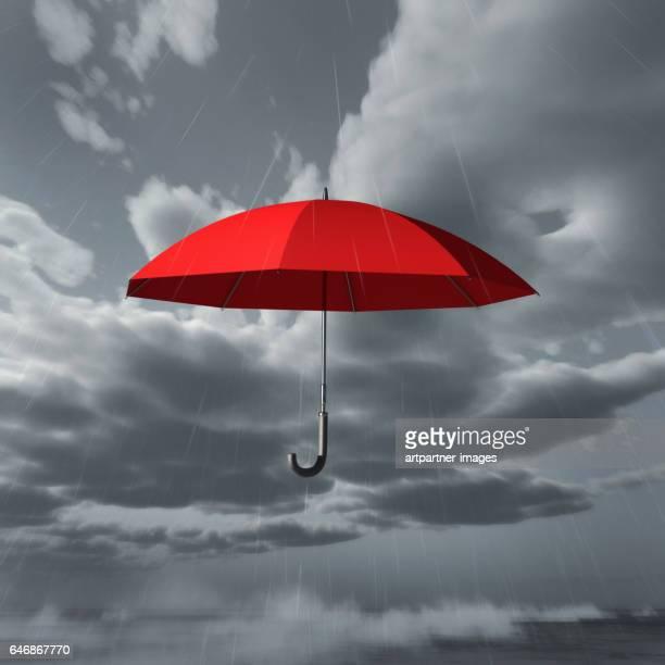 rain falls on red umbrella