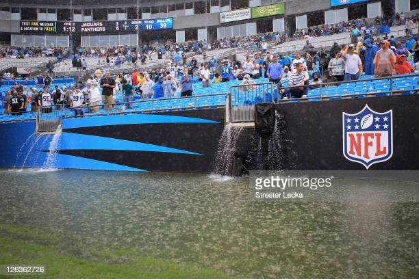 Rain falls on the field during the game between the Carolina Panthers and Jacksonville Jaguars at Bank of America Stadium on September 25 2011 in...