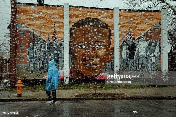 Rain falls on the Sandtown neighborhood where Freddie Gray dipicted in a mural with civil rights leaders lived and was arrested earlier this year...