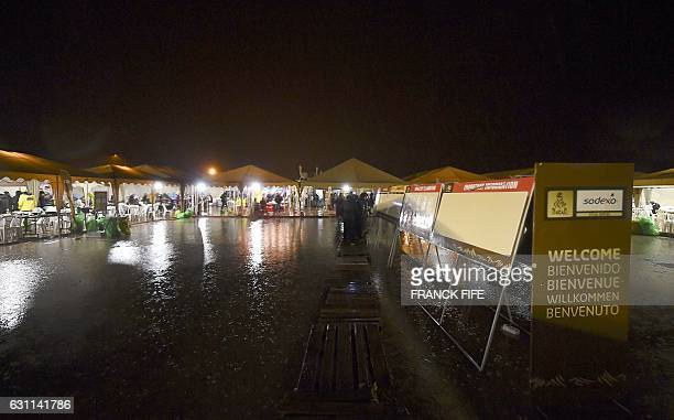 Rain falls over the bivouac of the 2017 Dakar Rally in Oruro Bolivia on January 6 2017 The Dakar was trapped by heavy rains on January 7 leading to...