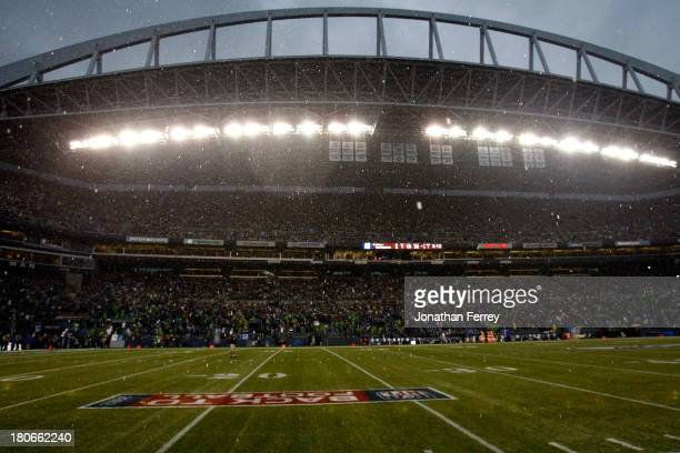 Rain falls to delay the game between the San Francisco 49ers and the Seattle Seahawks at Qwest Field on September 15 2013 in Seattle Washington