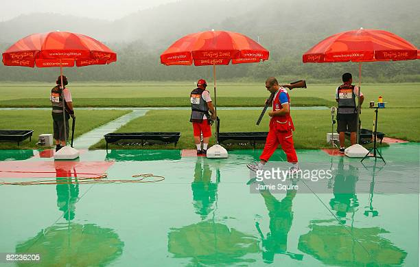 Rain falls while shooters compete in the men's trap qualification shooting event held at the Beijing Shooting Range Hall during Day 2 of the 2008...