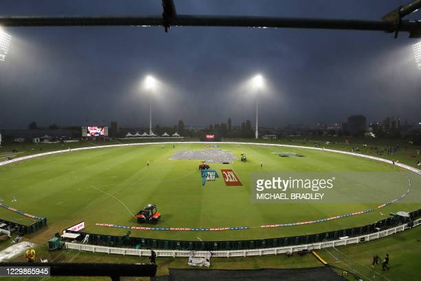 Rain forces a delay in play during the third Twenty20 International cricket match between New Zealand and the West Indies at the Bay Oval in Mount...