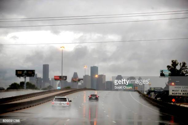 Rain from Hurricane Harvey batters the downtown area on August 26 2017 in Houston Texas Harvey which made landfall north of Corpus Christi late last...