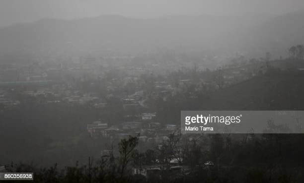 Rain hangs over homes and businesses three weeks after Hurricane Maria hit the island on October 11 2017 in Aibonito Puerto Rico The area is without...