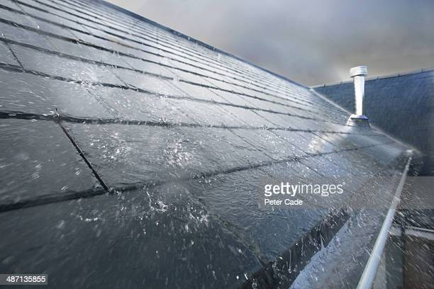rain hitting roof - weather stock pictures, royalty-free photos & images