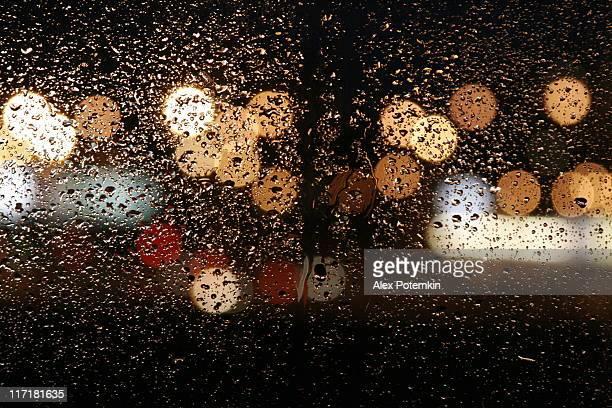 Rain in autumn. wet night windows - abstract background
