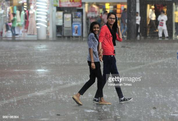 Rain in Sector 17 on May 8 2018 in Chandigarh India Dust storms rain and thunder lashed out in parts of northern India uprooting trees and blowing...