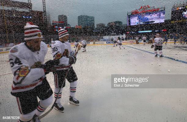 Rain is seen on the glass during warm ups prior to the 2017 Bridgestone NHL Winter Classic between the St Louis Blues and the Chicago Blackhawks at...