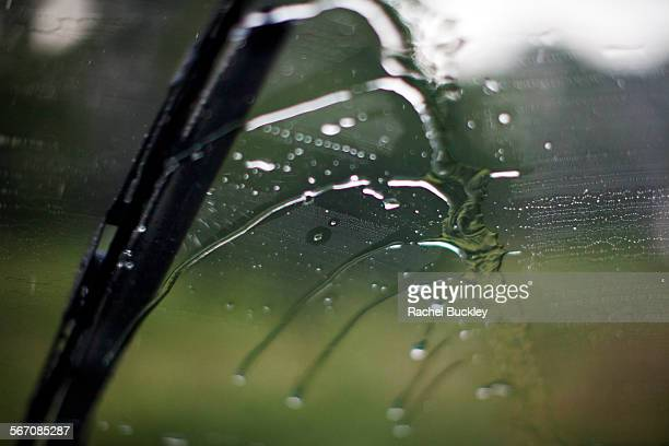 Rain is wiped away by a wiper blade.