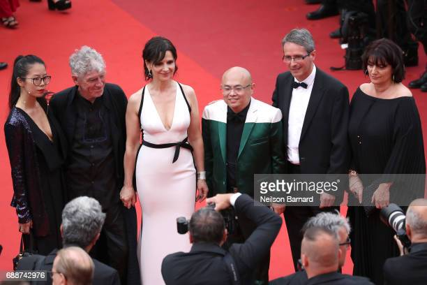 Rain Li Christopher Doyle Juliette Binoche and guests attend the 'Amant Double ' screening during the 70th annual Cannes Film Festival at Palais des...