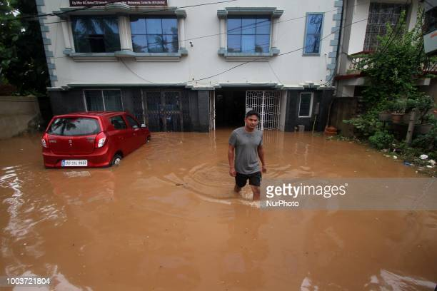 Rain logging waters submerge houses and vehicles as people comes out to safer place after flood water enters into their house after the heavy rain...