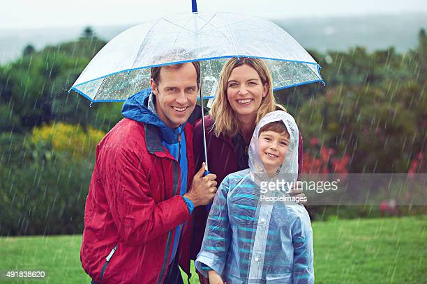 rain or shine, we love the outdoors - mother son shower stock photos and pictures