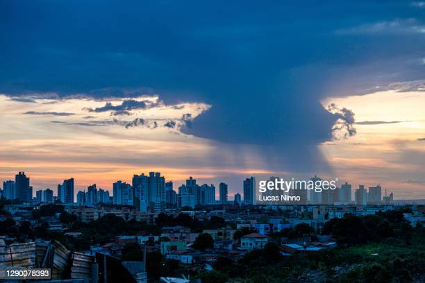 rain over city in brazil - クイアバ ストックフォトと画像