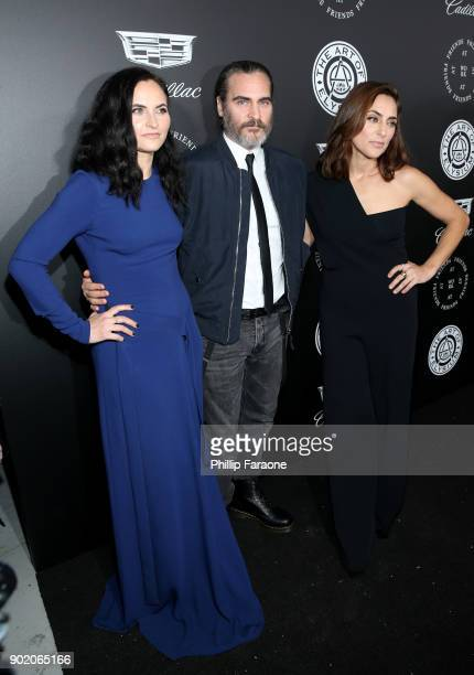 Rain Phoenix Joaquin Phoenix and Summer Phoenix attend The Art Of Elysium's 11th Annual Celebration with John Legend at Barker Hangar on January 6...