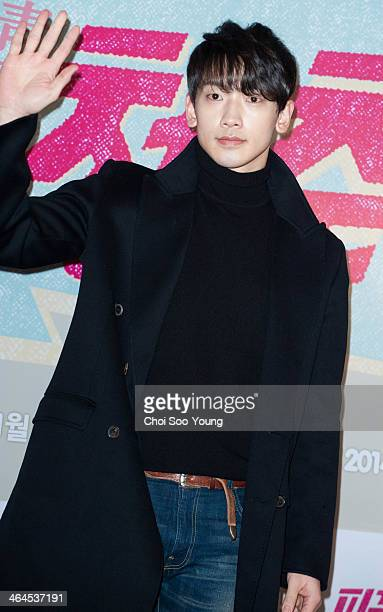 Rain poses for photographs during the movie 'Hot Young Bloods' VIP Premiere at Geondae Lotte Cinema on January 20, 2014 in Seoul, South Korea.