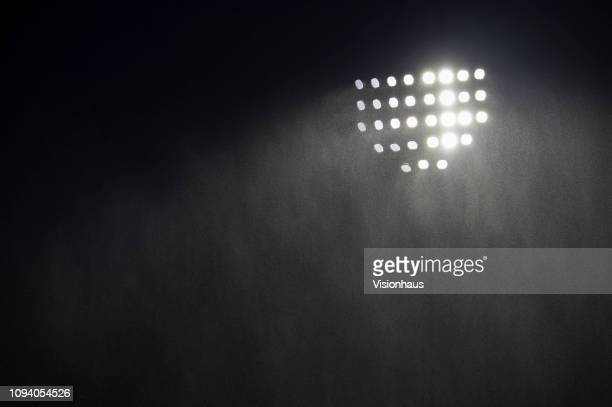 Rain pours down in front of a floodlight during the Premier League match between Burnley FC and Fulham FC at Turf Moor on January 12, 2019 in...