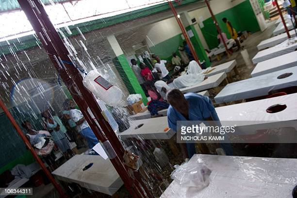 Rain pours through the roof in a ward full of cholera patients at the Charles Colimon hospital in Petite Riviere on the Artibonite river believed to...