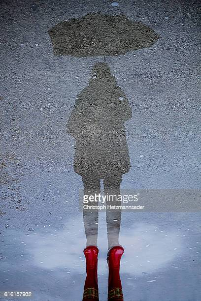 rain protection - optical illusion stock photos and pictures
