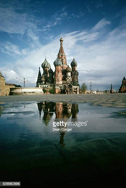 A rain puddle mirrors the onion domes of Ivan the Terrible's mid 16th century cathedral built to commemorate his victory over the Tsars