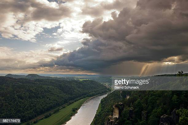 rain showers above elbe valley - bernd schunack stock-fotos und bilder
