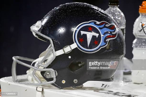 Rain soaked helmet of the Tennessee Titans rests on the sideline during a preseason game against the Pittsburgh Steelers at Nissan Stadium on August...