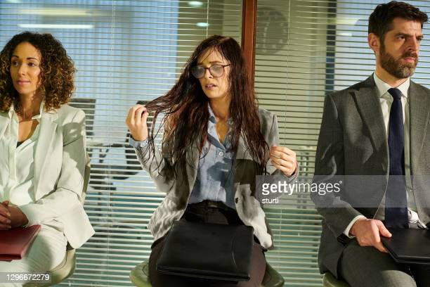rain soaked job candidate - bad luck stock pictures, royalty-free photos & images