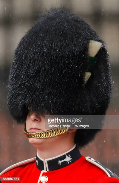 Rain soaks the bearskin hat of a member of the Welsh Guards during the Colonel's Review, the final rehearsal of Trooping the Colour, the Queen's...