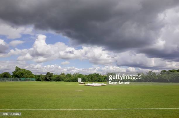 rain stopped play - cricket pitch - cricket pitch stock pictures, royalty-free photos & images
