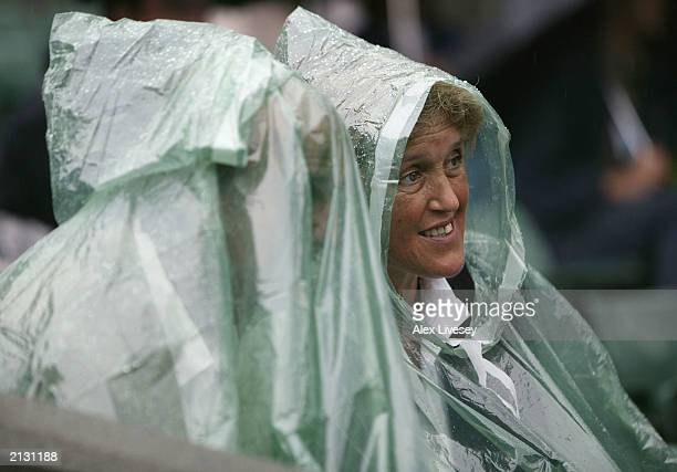 Rain stops play during the Mark Philippoussis of Australia against Alexander Popp of Germany men's quarter finals at the Wimbledon Tennis...