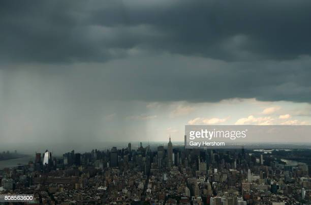 A rain storm moves across Manhattan behind the Empire State Building in New York City on July 3 2017