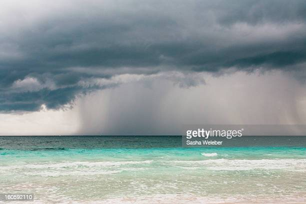 rain storm over the ocean and beach - sasha gray stock photos and pictures