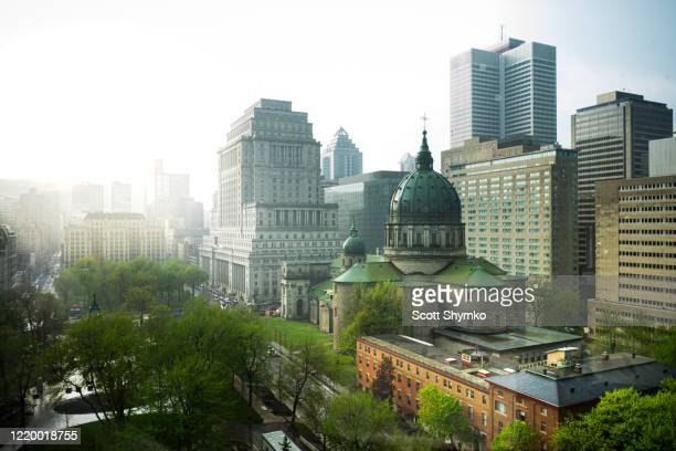 rain storm passes through downtown montreal, quebec - montréal stock pictures, royalty-free photos & images