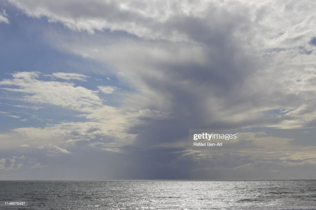 Rain storm raising over seascape : Stock Photo