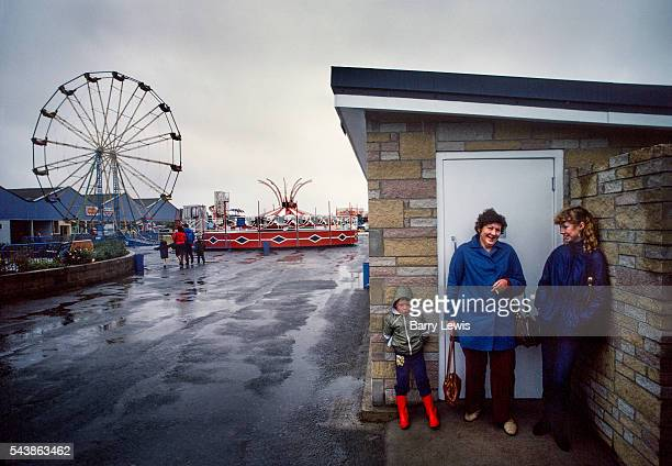 Rain trying to stop play in fairground Butlins Holiday camp Skegness Butlins Skegness is a holiday camp located in Ingoldmells near Skegness in...